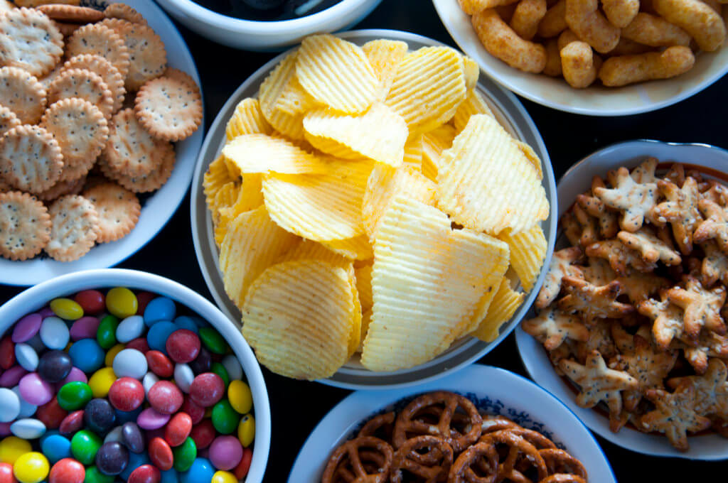 A selection of junk food like potato chips and sugary crackers that have a high glycemic index.